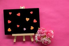 Blackboard with Love Heart on pink background and copy space, Love icon, Happy Valentines Day. Relationships concept royalty free stock images