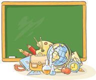 Blackboard with many school things Royalty Free Stock Photos