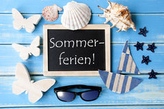 Blackboard With Maritime Decoration, Sommerferien Means Summer Holidays Royalty Free Stock Photos