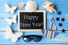 Blackboard With Maritime Decoration And Text Happy New Year Stock Photo
