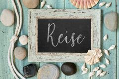 Blackboard with text, sea shells, rope and star fish decorations Stock Image