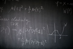 Blackboard with math lesson Stock Images