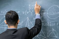Instructors are teaching mathematics. Blackboard with mathematical content, Writing with a variety of colors. To stimulate teaching, Front side Royalty Free Stock Images