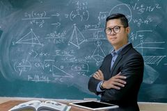 Instructors are teaching mathematics. Blackboard with mathematical content, Writing with a variety of colors. To stimulate teaching, Front side Stock Photos