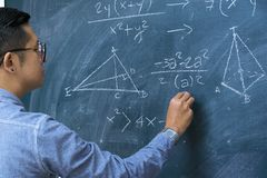 Instructors are teaching mathematics. Blackboard with mathematical content, Writing with a variety of colors. To stimulate teaching, Front side Stock Photography