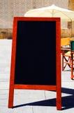 Blackboard menu. A blank blackboard menu on a restaurant terrace Royalty Free Stock Images
