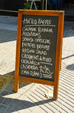 Blackboard menu. A blackboard menu on a restaurant terrace Royalty Free Stock Images
