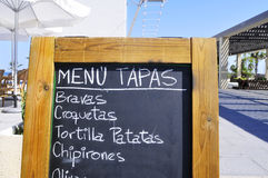 Blackboard menu. A blackboard menu with tapas on a restaurant terrace Royalty Free Stock Photos