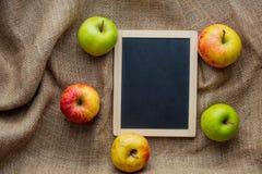 Blackboard menu and apples Stock Photo