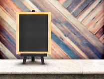 Blackboard menu with easel on marble table with blur diagonal wo Stock Images