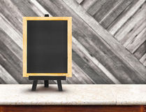 Blackboard menu with easel on marble table with blur diagonal wo Royalty Free Stock Photos