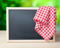 Blackboard menu recipe frame picnic cloth background. Stock Image