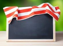 Blackboard menu recipe frame picnic cloth background. Stock Image