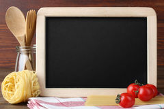 Blackboard menu. On a wooden background Royalty Free Stock Image