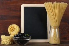 Blackboard menu. On a wooden background Royalty Free Stock Photos