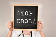 Blackboard with the message Stop Ebola. Blackboard with the message in a blackboard Stop Ebola Royalty Free Stock Image