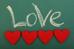 Blackboard miłość z cztery sercami Zdjęcia Stock