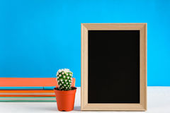 Blackboard with mock up frame and book pencil on the wood table Stock Photography