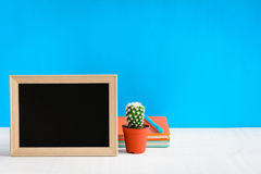 Blackboard with mock up frame and book pencil on the wood table Stock Image