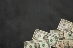 Blackboard with money Royalty Free Stock Photo
