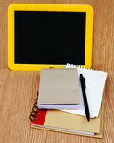 Blackboard and notebook Royalty Free Stock Photo