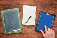 Blackboard, notepad and digital tablet Stock Photography