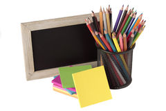 Blackboard, notes and colored pencils Stock Photo