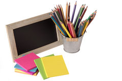 Blackboard, notes and colored pencils Stock Image