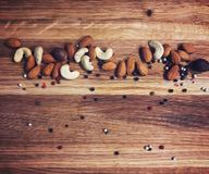 Blackboard with nuts stock images