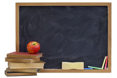 Blackboard with old textbooks and apple Stock Photos