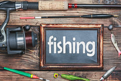 Blackboard and other fishing accessories Stock Photography