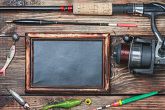 Blackboard and other fishing accessories Stock Image