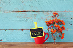 Blackboard over blue wooden shelf with the phrase have a nice weekend Royalty Free Stock Photo