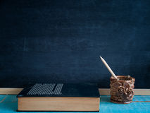 Blackboard , pencil  and books. Blackboard , pencil  and books , on the table in the classroom Royalty Free Stock Images