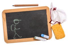 Blackboard with pencil, chalk, sponge cloth and a drawing Stock Photo