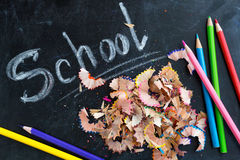 Blackboard with pencils and chips Stock Images