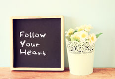 Blackboard with the phrase follow your heart written on it Royalty Free Stock Photo