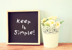 Blackboard with the phrase keep it simple written on it. Royalty Free Stock Image