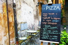 Blackboard of a pizzeria in Rome Stock Images