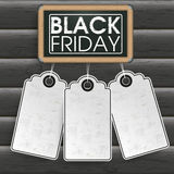 Blackboard Price Stickers Black Friday Wood. Blackboard with price stickers on the wooden background Royalty Free Stock Images