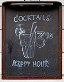 Blackboard promoting cocktails & happy hour Royalty Free Stock Photo