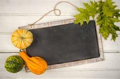 Blackboard with pumpkin. Copy space Stock Photo