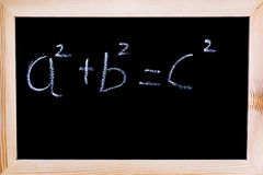 Blackboard with white chalk writing. Blackboard with Pythagoras` theorem written on it Stock Images