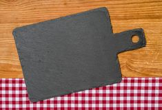 Blackboard with a red checkered tablecloth Stock Image