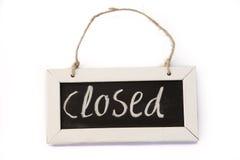 Blackboard on rope closed Stock Photo