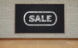 Blackboard with sale symbol Stock Photo