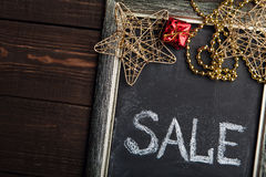 Blackboard with Sale text and New Year decorations Stock Photo