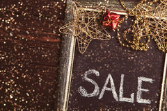 Blackboard with Sale text and New Year decorations Royalty Free Stock Photo