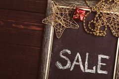 Blackboard with Sale text and New Year decorations Royalty Free Stock Photography