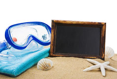 Blackboard on the sand and other things for the beach Royalty Free Stock Image